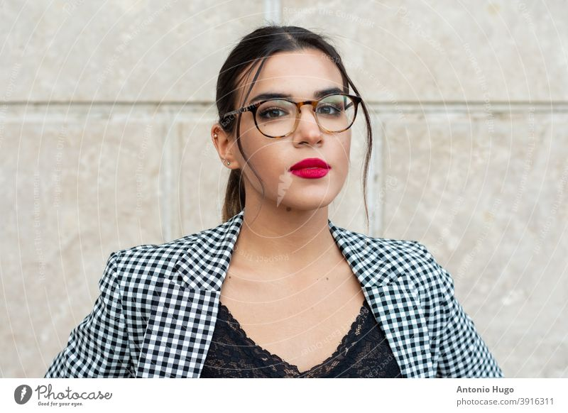 Portrait of a sensual young brunette business woman with red painted lips and glasses. portrait secretary red lips eyeglasses office exterior lace clothes sexy