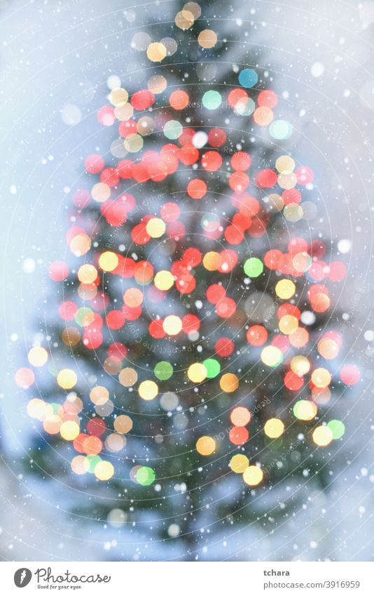Blurred Christmas tree with colorful lights on white background bokeh Public Holiday Abstract Light Christmas decoration Bright defocused Design blurriness