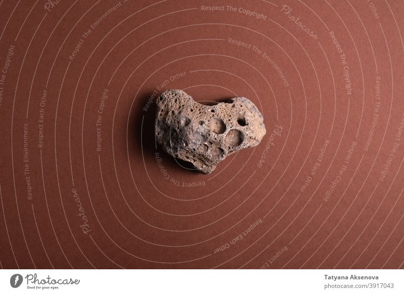 Heart shaped stone on brown rock abstract textured heart geology material rough nature old close-up cracked mineral surface detail no people