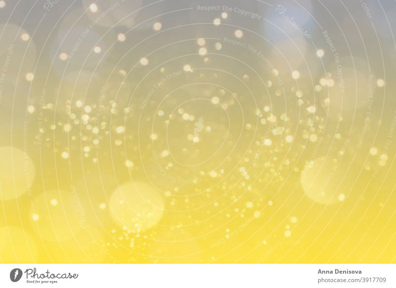 Abstract light, bokeh pattern gradient blurred heart love background defocus illuminating yellow ultimate gray grey color year trend 2021 glitter silver golden