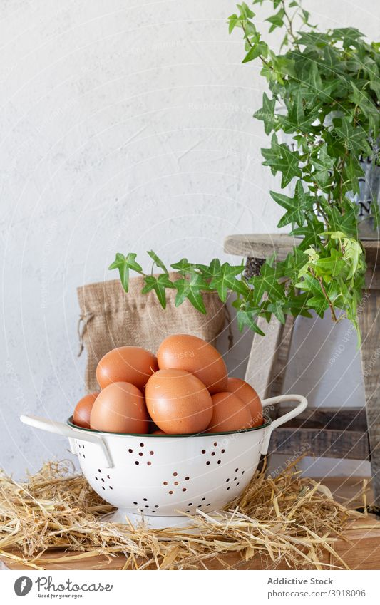 Brown eggs in bowl on kitchen table brown heap food pile meal ingredient cook nutrition easter cuisine natural culinary fresh organic prepare protein edible