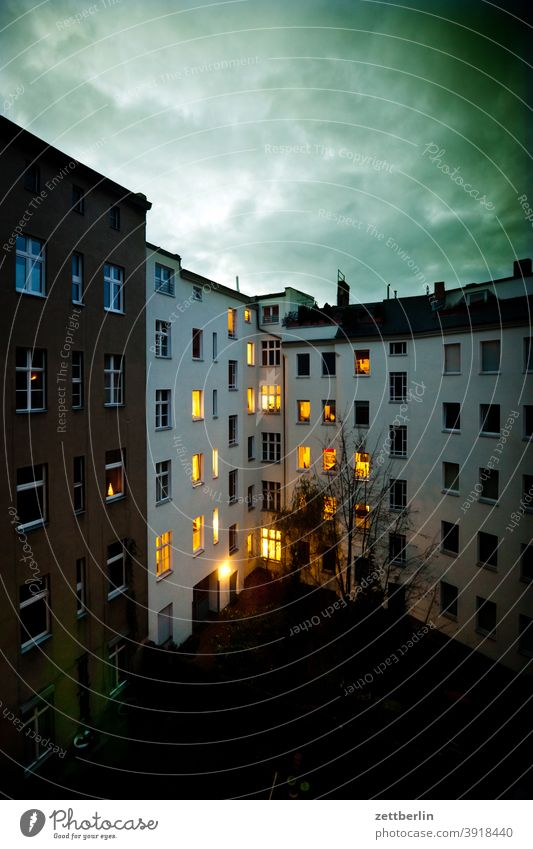 Illumination in the backyard Evening Advent Old building on the outside decoration Decoration Dark Facade Window House (Residential Structure) rear building