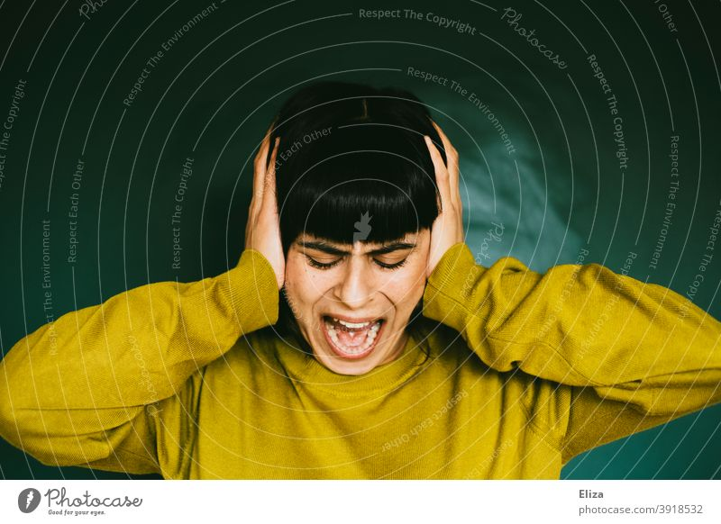 Angry woman covers her ears and screams loudly Anger Woman rabid Scream Distress Sour Frustration Aggression Aggravation Human being Emotions Grouchy Stress