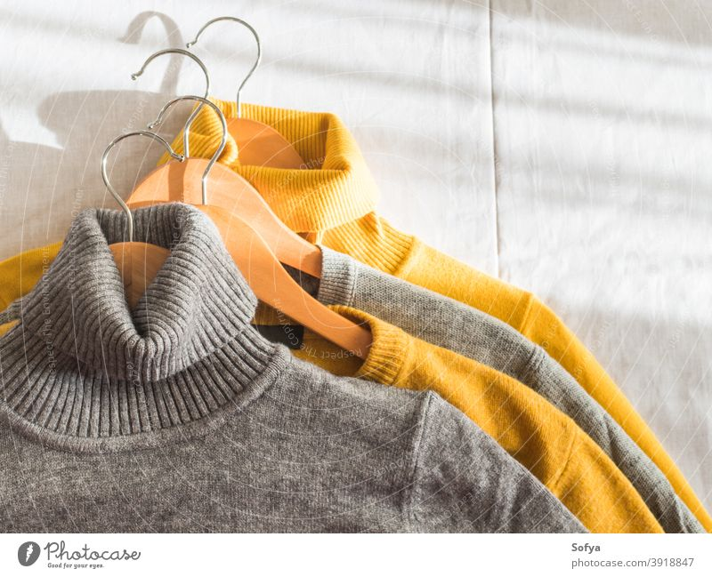 Yellow illuminated color and gray winter sweaters yellow autumn hanger cashmere fall background knit cozy fashion warm knitwear fabric soft woolen girl above
