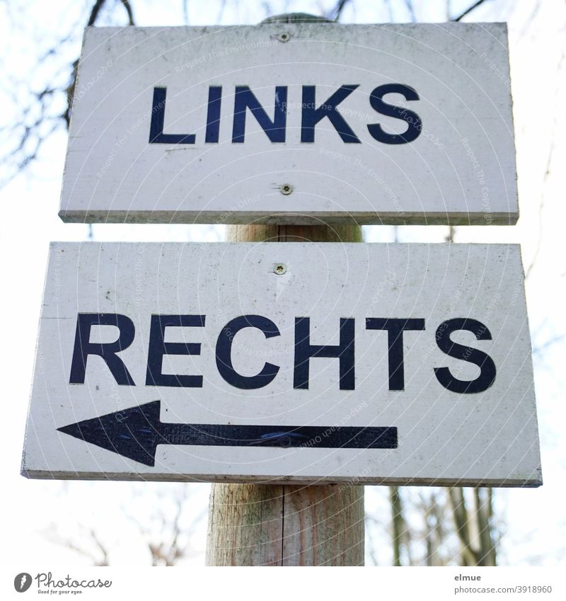 """Lured by right turners / on two signs screwed on top of each other it says """"LEFT"""" and """"RIGHT"""" - on the sign """"RIGHT"""" the arrow points to the left / the other one to the right / orientation / direction"""