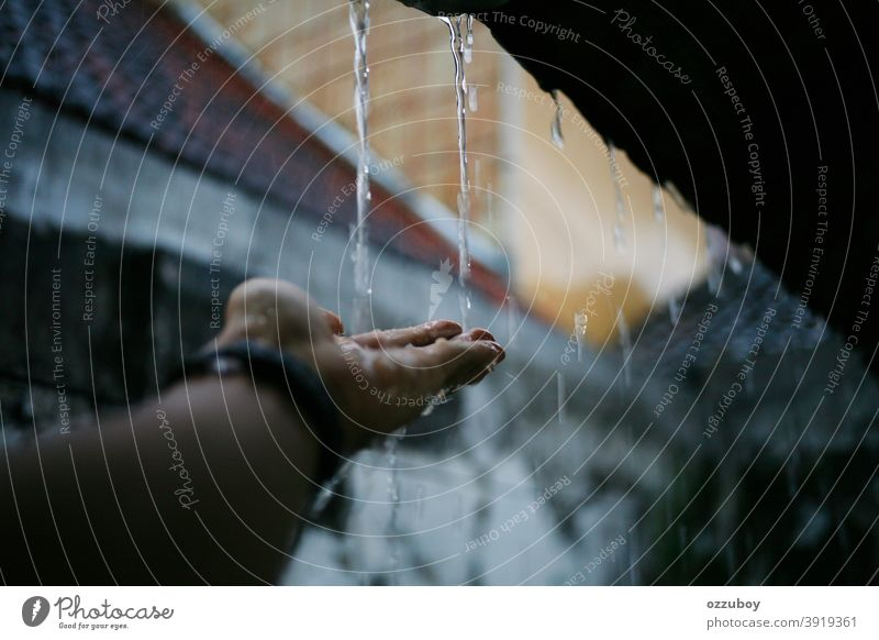 rainy season Rain Weather Hand Water Rainy weather Drops of water Wet rainy day raindrops Bad weather Colour photo Copy Space