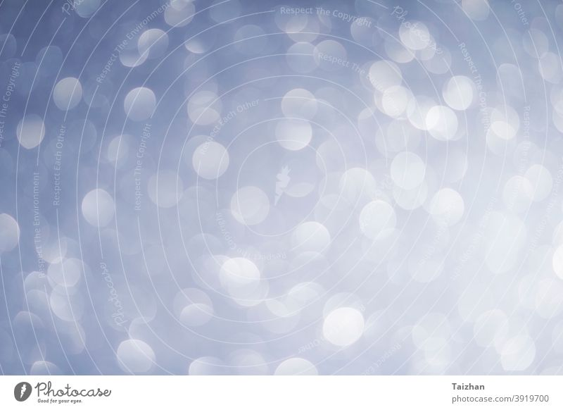 abstract blur white, blue  and silver color background with star glittering light snowflake glamour glowing shiny defocused pattern winter bling boke diamond