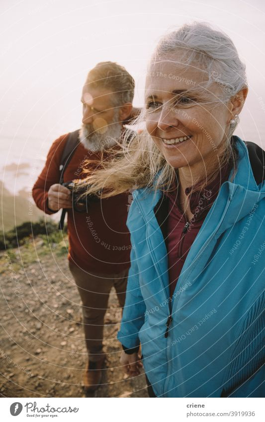 happy senior couple hiking together at sunset old elderly woman people love family smiling beach portrait mature retirement grandmother outdoors smile doctor