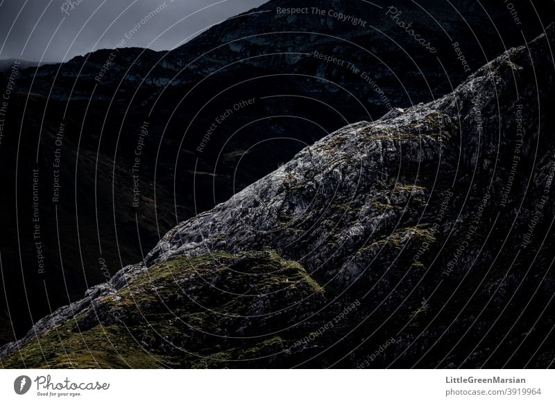 Illuminated mountain side Mountain Light Shadow Contrast high contrast darkness Rock Moss Grass Clouds Stone Rubble Steep Hiking Alpine Landscape Exterior shot