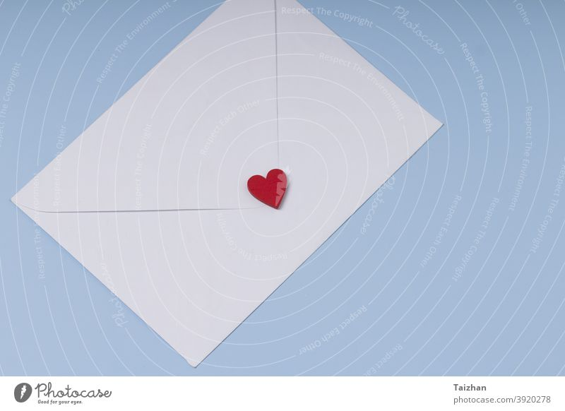 Envelope and red heart on blue background . Gift, message for lover. Valentine day greeting concept. mail anniversary envelope paper design gift symbol