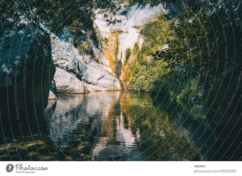 landscape of a small waterfall in a forest of tarragona, spain prades peaceful serene tranquility exploration meditate pure purity zen refresh relaxing solitude
