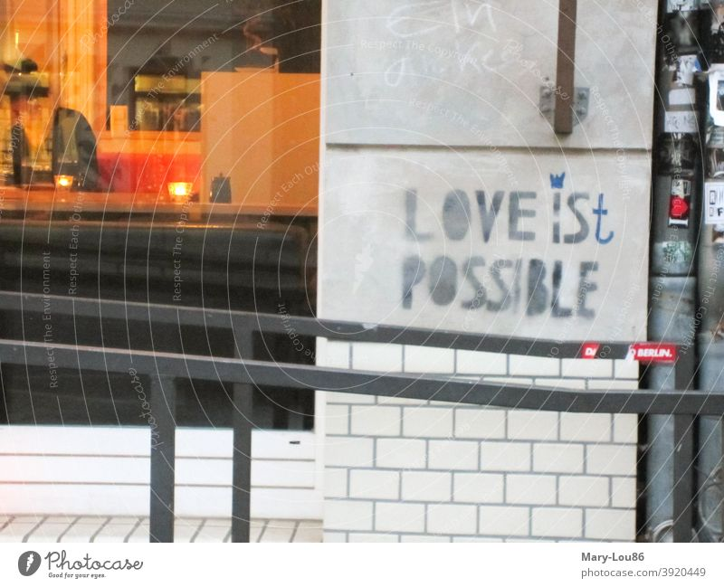"""Saying on wall """"Love is(t) possible"""" saying Wall (building) Love is possible Roadhouse graffiti typography street art urban Exterior shot Romance Graffiti"""