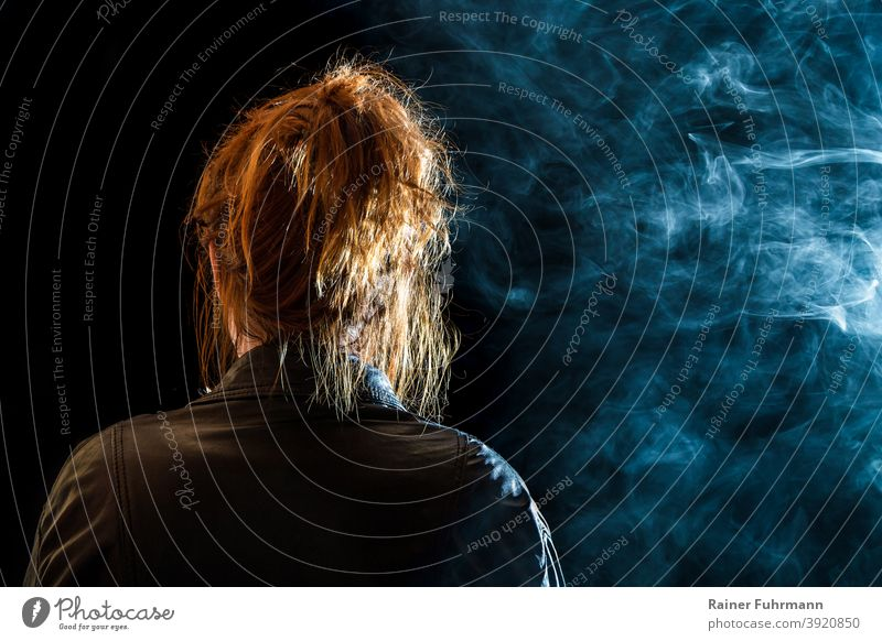back view of a redheaded woman, she looks into the darkness Woman at night Night Light Floodlight Anonymous on one's own Lonely silent Loneliness sad unhappy