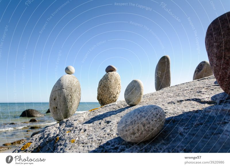 Steinmandl standing on a big stone and looking at the sea Steinmännl Stonemasons Ocean Lake Baltic Sea Stand stand in a row Row Beach Water Nature coast