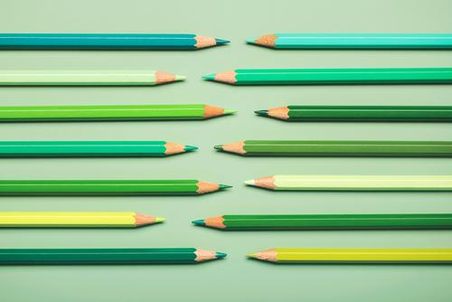 interlocking pencils in green tones color pencils college palette rainbow closeup colorful object concept draw fence row texture wooden multicolor objects craft
