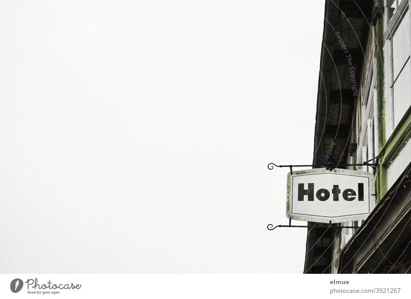 """""""Hotel"""" is written on the sign on the building / prohibition of accommodation / overnight stay. Building Hotel sign Metal Signage Characters Facade Window"""