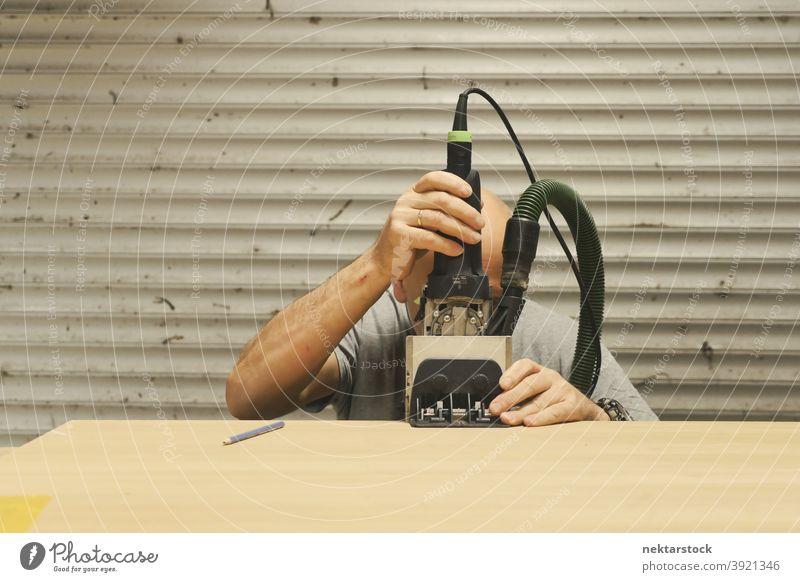 Carpenter Using Wood Framing Tool man wood framing tool caucasian worker workshop diy no hair 1 person garage working line carpenter carpentry handiwork