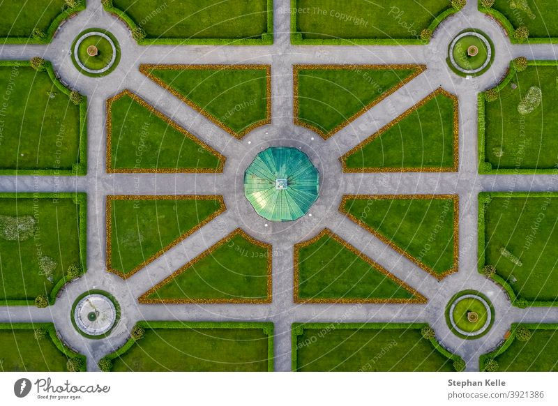 Symmetrial aerial view at a green park with a temple in its center, straight top down from above, popular architecture photo. special sightseeing balance path