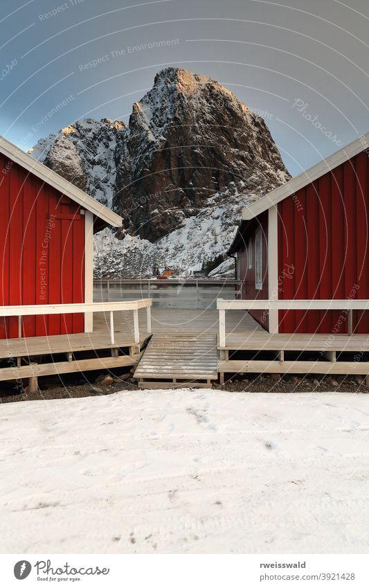 Tourist rorbuer-traditional fishing cottages-Festhaeltinden mount across the fjord. Hamnoy-Reine-Moskenesoya-Lofoten-Norway. 0225 fishing port village hamlet