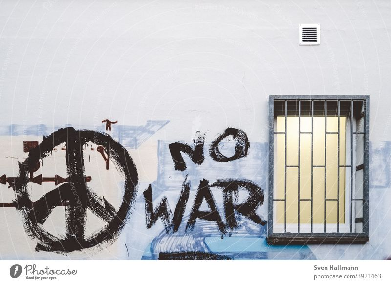 Graffiti on wall with window peace War Peace No War was Window Grating latticed Force Wall (building) Gray Exterior shot Wall (barrier) Characters Colour photo