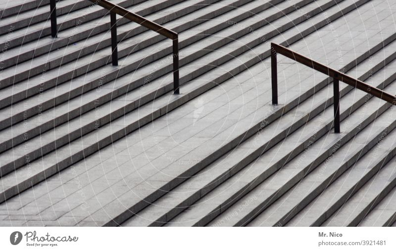 Open staircase Architecture concrete staircase Downward Upward Above Manmade structures Stairs lines Structures and shapes Gray Steps upstairs Stone steps