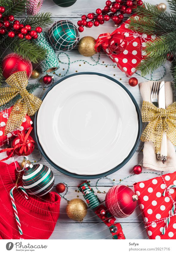 Christmas dinner table plate setting with decor christmas polka dot dish background food red party lunch frame flat lay celebrate festive tree design vintage