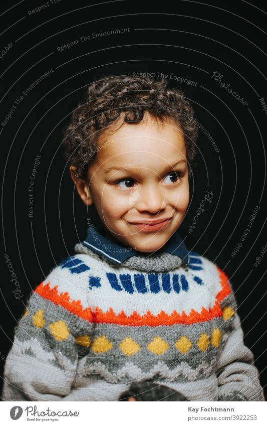 studio portrait of cute black boy smiling african american boys carefree casual clothing child childhood children cold emotion expression freedom happiness