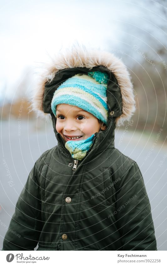 picture of smiling black boy outdoors african american boys carefree casual clothing child childhood children cold emotion expression freedom happiness happy