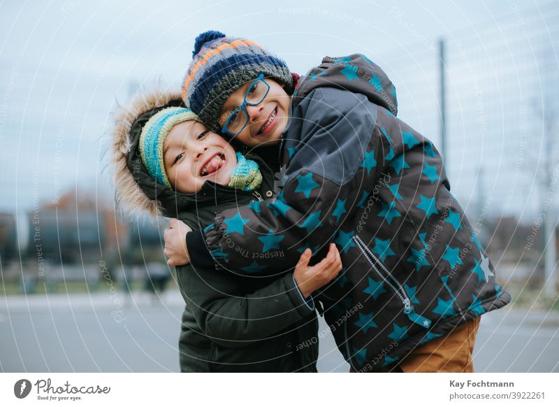 two young brothers give each other a hug activity african black boy buddy child childhood children family friends fun happiness happy joy kid leisure lifestyle