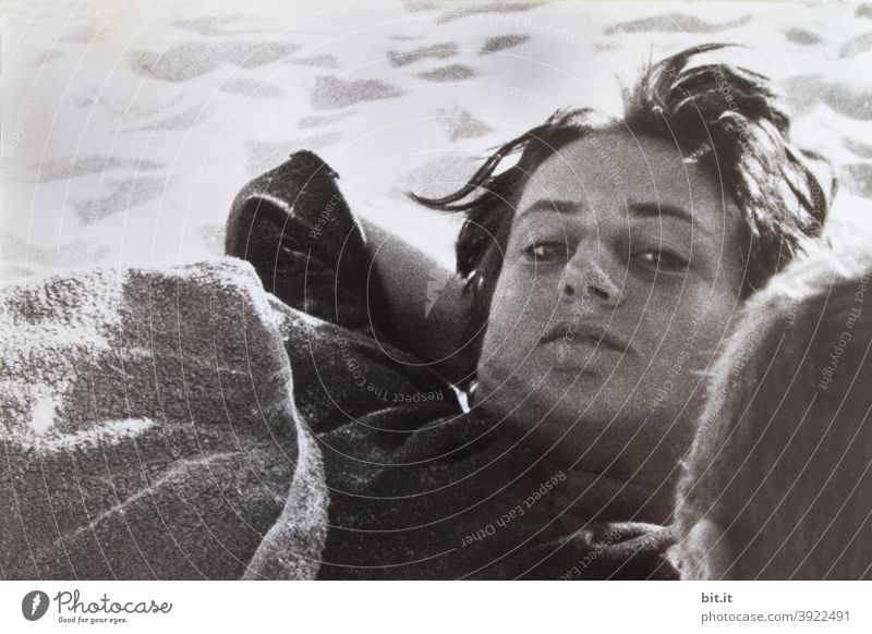bitti lies l on the beach of portugal Woman Young woman Beach Lie Human being Feminine 18 - 30 years Looking into the camera Face portrait Black & white photo