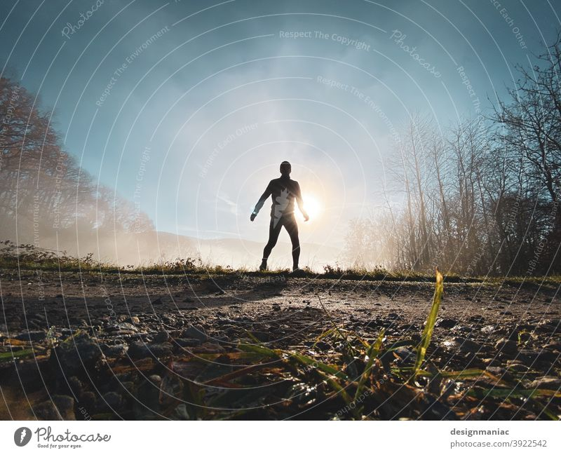The X-Files: The Jogger in the Mist Silhouette Fog Above the clouds Clouds Amazing Mystic File x trees Lanes & trails Grass Cold cold season Sky Sky blue cloudy