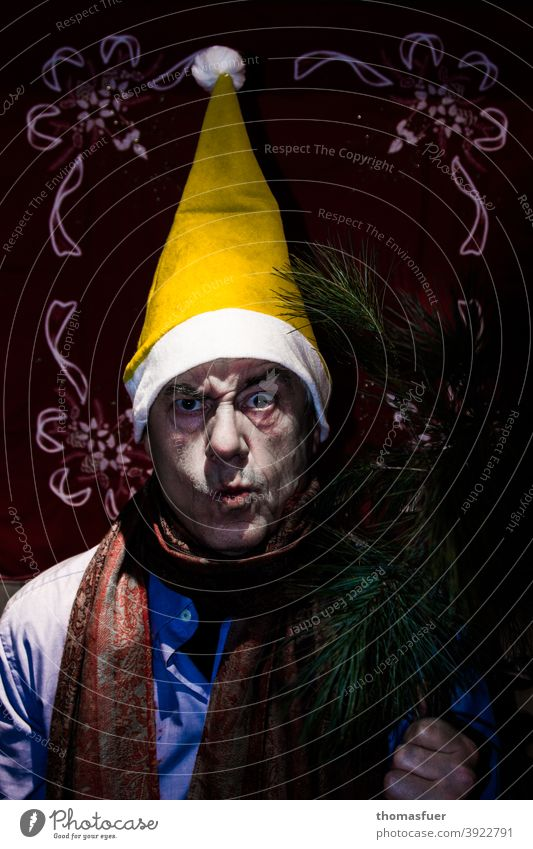 Santa Claus with yellow cap looks angry, a little pale - maybe Corona ;-) Santa Claus hat Cap Colour photo Interior shot Christmas & Advent Yellow Evil evil eye