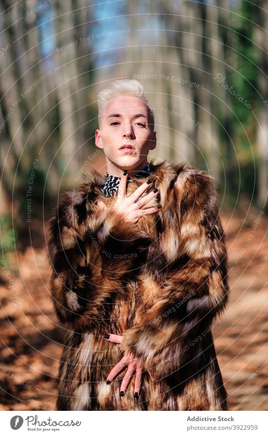 Fashionable transgender man in fur coat lgbt fashion style young blond alternative outfit male homosexual sensual gay lifestyle lgbtq individuality personality