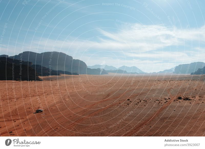 Amazing view of dry desert and mountains on sunny day sandstone valley landscape scenery hot climate wadi rum jordan blue sky formation nature terrain rock