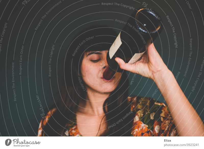 Young woman drinking red wine from bottle Vine Drinking Bottle Red wine Alcoholic drinks alcohol consumption get drunk drink wine from the bottle