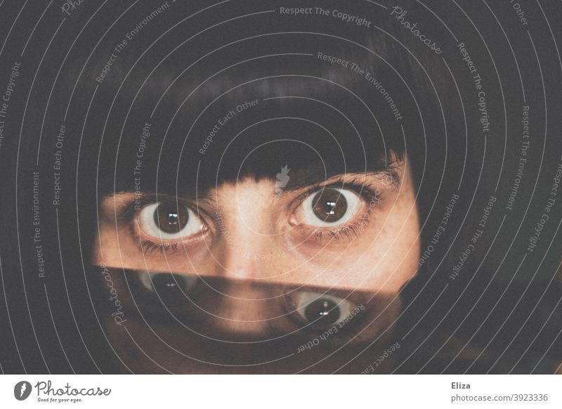 Eyes of a woman with reflection eyes double Looking haunting four Face Looking into the camera Woman Bangs mirrored portrait somber Earnest Dark Dark-haired