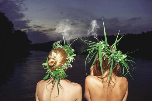 Sometimes you need to relax. Maybe have a trip to some country lakeside and chill out with friends. These two girls might be smoking something more natural after all during this perfect midsummer evening.