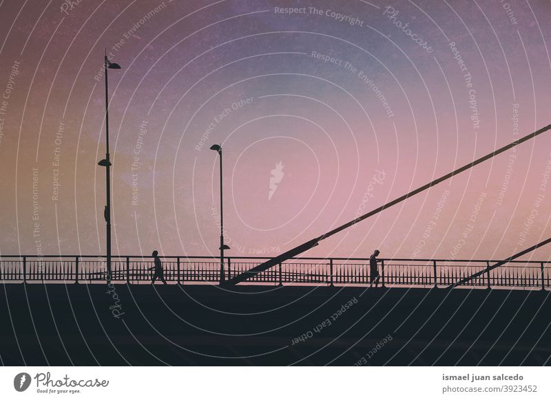 tourist on the bridge visiting Bilbao city, Spain person people pedestrian shadow silhouette sunset street outdoors minimal action walking tourism