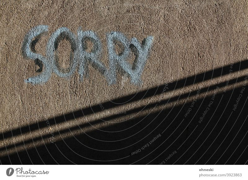 Sorry Graffiti Wall (building) Facade Characters Letters (alphabet) Typography Exterior shot Wall (barrier) Deserted Youth culture Street art Trashy sorry