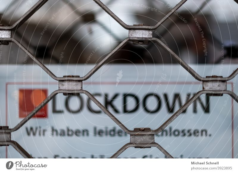 "Closed store with bars and lettering ""Lockdown - Sorry, we're closed."" I corona thoughts lockdown pandemic Corona virus coronavirus Risk of infection prevention"