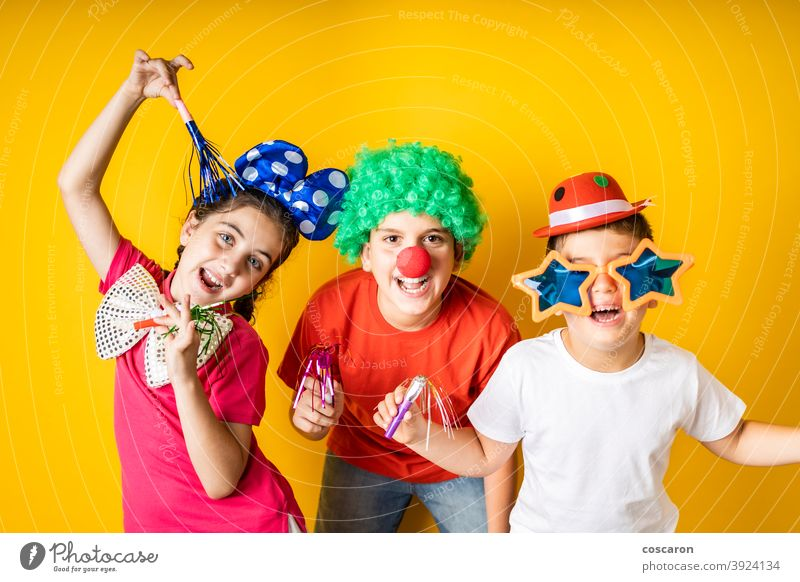 Three kids celebrating Carnival or New Years Eve at home background beautiful boy carnival celebrate celebration child childhood children costume cute