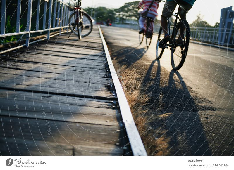 people crossing the bridge with bicycle outdoor person cyclist lifestyle cycling man recreation sport transportation adult bike road adventure summer horizontal