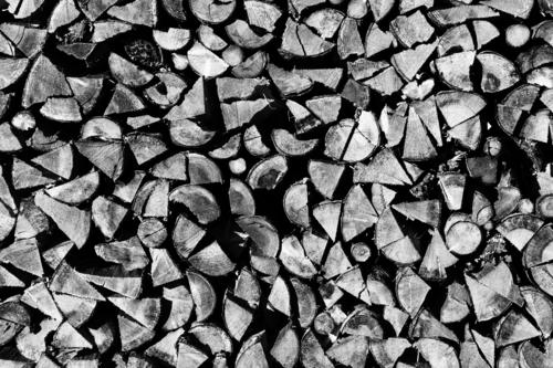 A Black Forest woodpile Wood Stack of wood Firewood Supply stacked Fuel Forestry Exterior shot Deserted Black & white photo