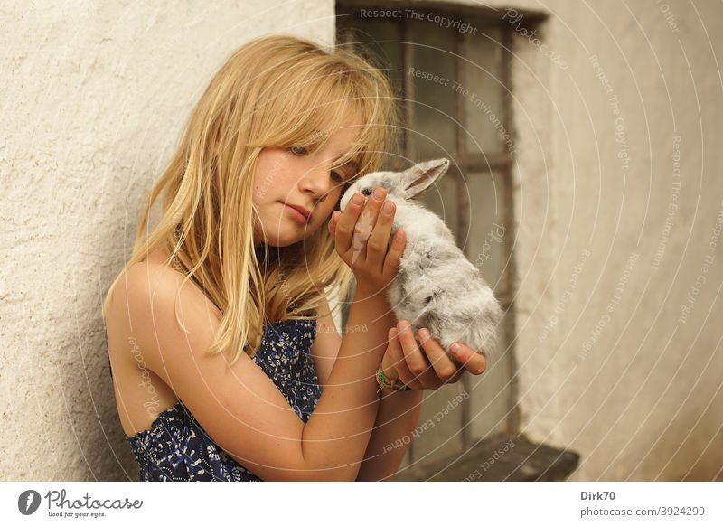 Young girl with rabbit young girl Girl Girlish romantic affectionately Love of animals Animal lover animal friendship Delicate tenderness Small Cute cautious