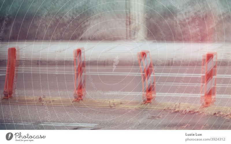 Guidance beacons and road markings are reflected in a shop window pane Street Facade Shop window Guide beacon Guide beacons Warped slanting reflection Town