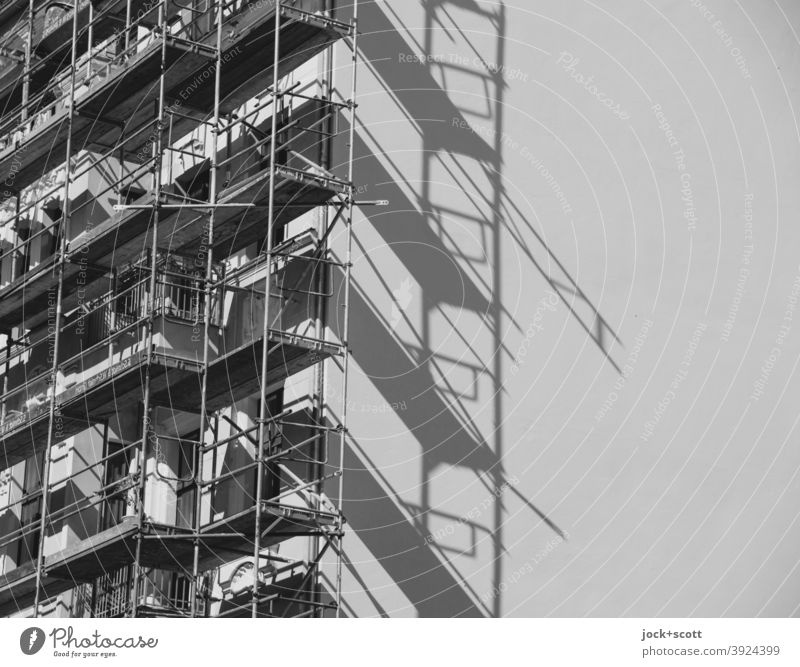 Scaffolding in front of the house Prenzlauer Berg Construction site Fire wall Facade Build Sharp-edged Authentic Symmetry Safety Change Shadow play Diagonal