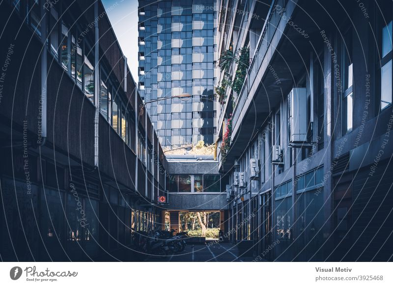 Dark alley and modern buildings of a contemporary city Alley Architecture Building Facades Exterior Construction structures Fronts Window urban metropolitan