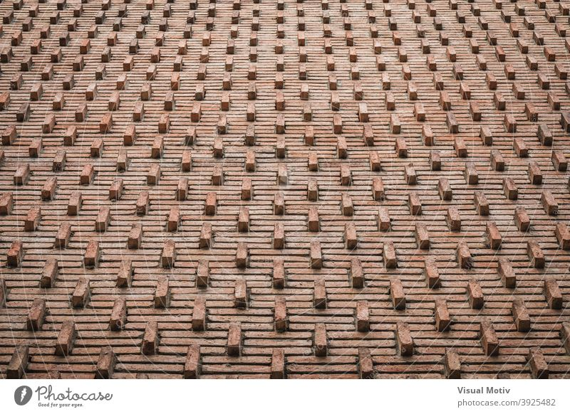 Background of an ornamental red brick wall from early 30s bricks background abstract texture pattern architecture design old brown surface detail solid rows