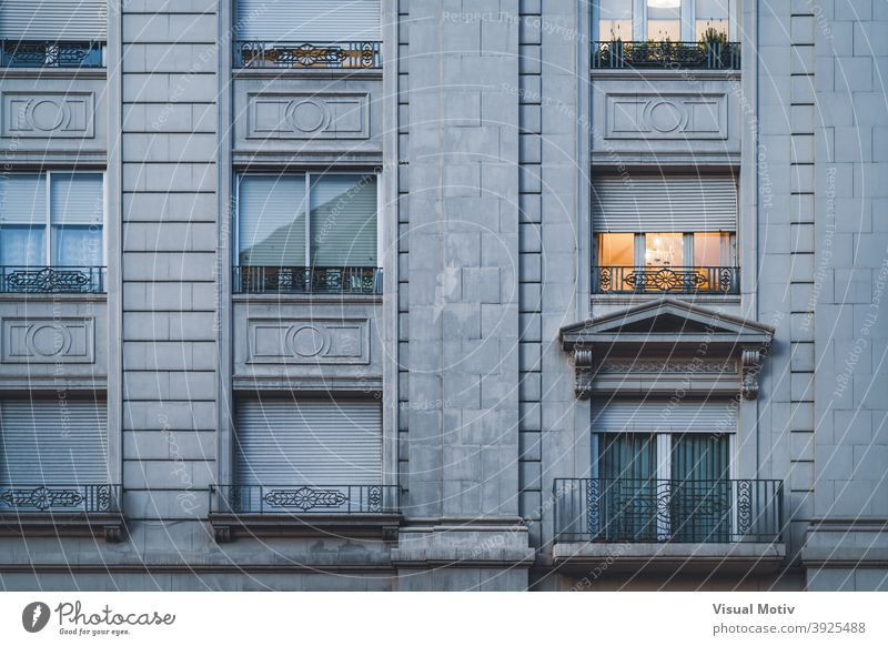 Balcony and rows of windows of an urban residential building in neoclassical style architecture facade exterior structure construction metropolitan balcony