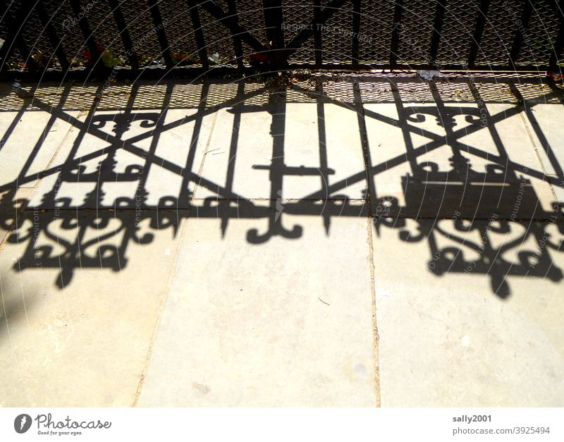 The shadow of the gate... Goal Main gate Entrance Shadow Wrought iron England door Closed Old Front door Structures and shapes Lock Metal Safety Exterior shot